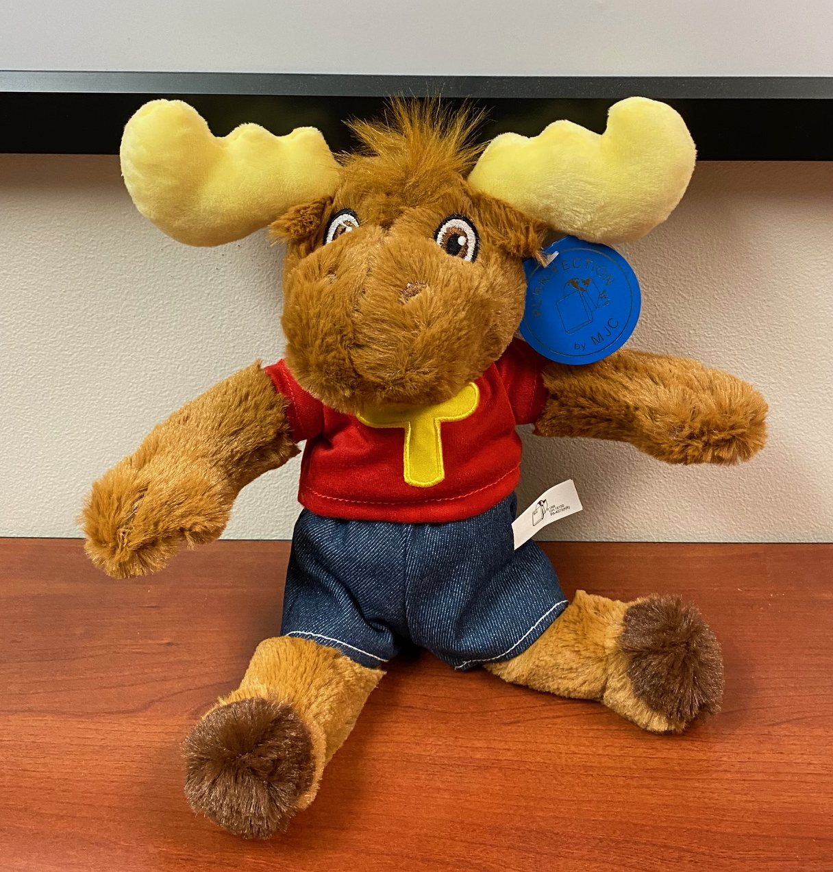 A picture of the Tommy Moose plush animal.